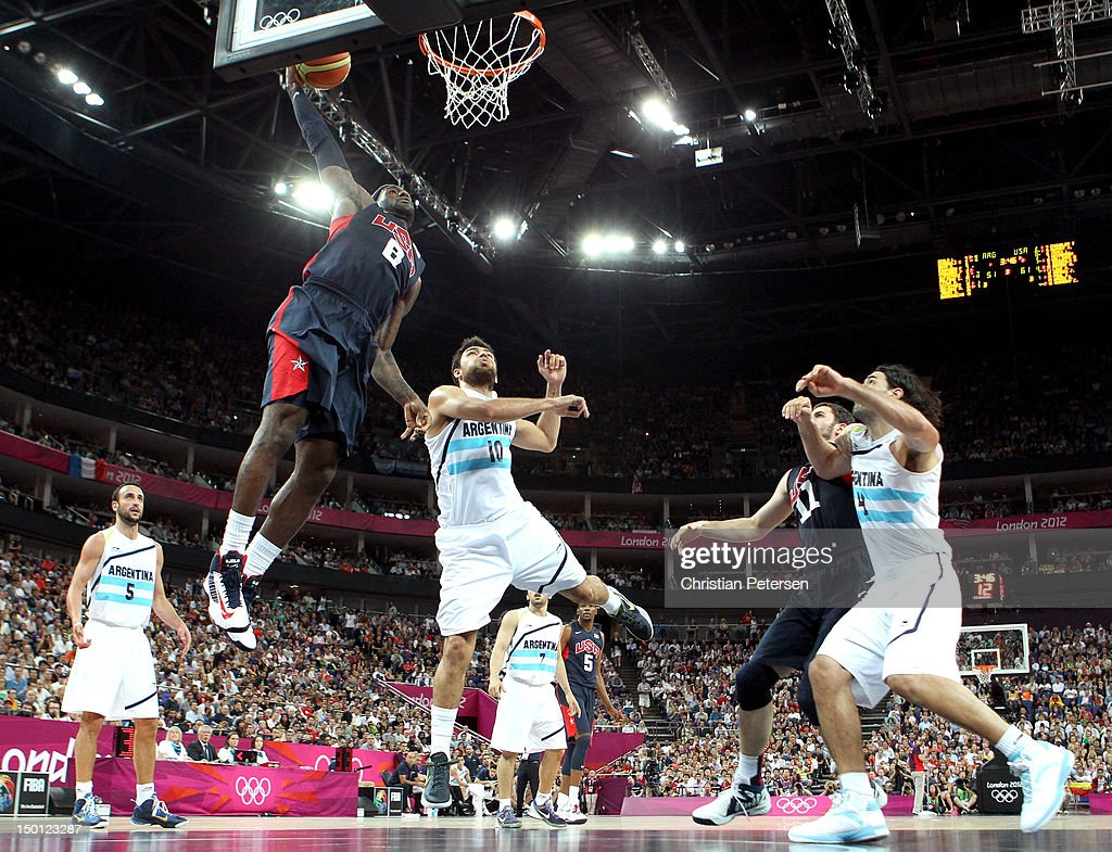 LeBron James #6 of United States goes up for a dunk over Carlos Delfino #10 of Argentina in the second half during the Men's Basketball semifinal match on Day 14 of the London 2012 Olympic Games at the North Greenwich Arena on August 10, 2012 in London, England.