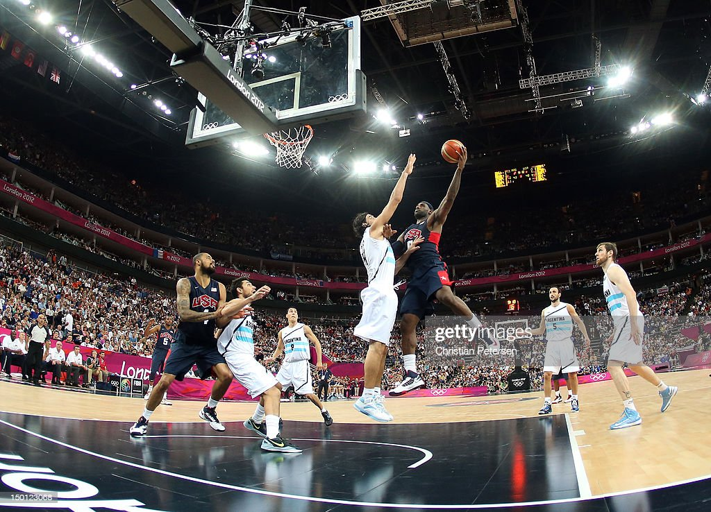 <a gi-track='captionPersonalityLinkClicked' href=/galleries/search?phrase=LeBron+James&family=editorial&specificpeople=201474 ng-click='$event.stopPropagation()'>LeBron James</a> #6 of United States goes up for a shot against <a gi-track='captionPersonalityLinkClicked' href=/galleries/search?phrase=Luis+Scola&family=editorial&specificpeople=2464749 ng-click='$event.stopPropagation()'>Luis Scola</a> #4 of Argentina in the second half during the Men's Basketball semifinal match on Day 14 of the London 2012 Olympic Games at the North Greenwich Arena on August 10, 2012 in London, England.