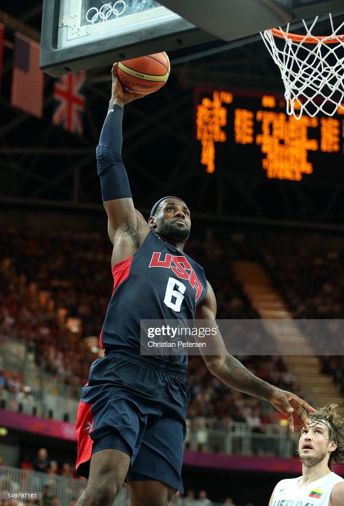 Lebron James #6 of United States goes up for a slam dunk against Lithuania during the Men's Basketball Preliminary Round match on Day 8 of the London 2012 Olympic Games at the Basketball Arena on August 4, 2012 in London, England.