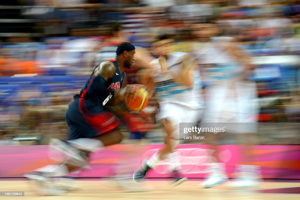 LeBron James #6 of United States moves the ball against Carlos Delfino #10 of Argentina during the Men's Basketball semifinal match on Day 14 of the London 2012 Olympic Games at the North Greenwich Arena on August 10, 2012 in London, England.