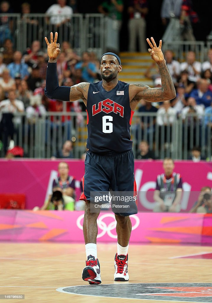 Lebron James #6 of United States reacts after making a three point shot against Lithuania during the Men's Basketball Preliminary Round match on Day 8 of the London 2012 Olympic Games at the Basketball Arena on August 4, 2012 in London, England.