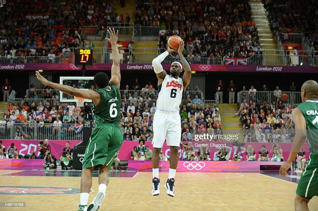 LeBron James of US Senior Men's National Team shoots against Ike Diogu of Nigeria during their Basketball Game on Day 6 of the London 2012 Olympic...