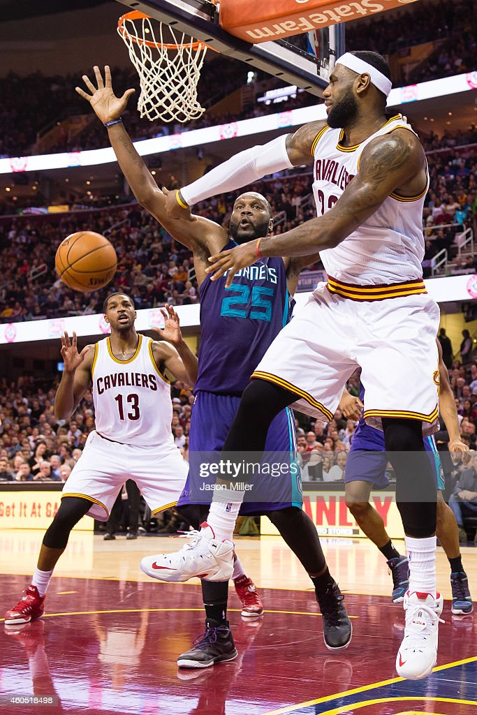 LeBron James #23 passes around Al Jefferson #25 of the Charlotte Hornets to Tristan Thompson #13 of the Cleveland Cavaliers during the second half at Quicken Loans Arena on December 15, 2014 in Cleveland, Ohio. The Cavaliers defeated the Hornets 97-88.