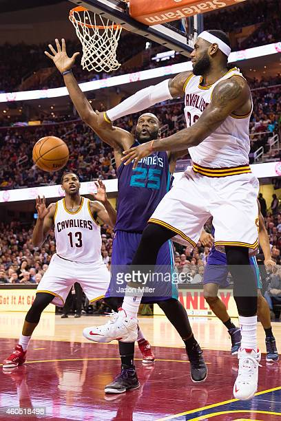 LeBron James passes around Al Jefferson of the Charlotte Hornets to Tristan Thompson of the Cleveland Cavaliers during the second half at Quicken...