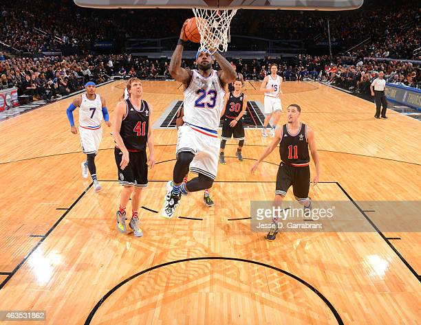 LeBron James playing for the East Coast allstars goes up of the dunk during the 2015 NBA AllStar Game at Madison Square Garden on February 15 2015 in...