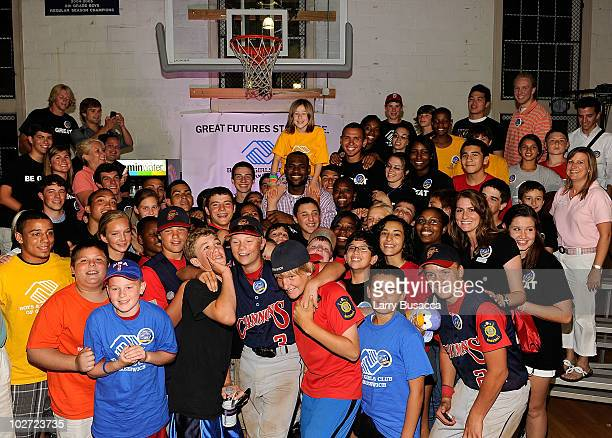 LeBron James poses with children from the Boys Girls Club of America at the LeBron James announcement of his future NBA plans at the Boys Girls Club...