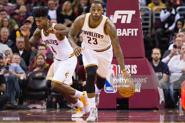 LeBron James takes the ball down court followed by Iman Shumpert of the Cleveland Cavaliers during the first half against the Chicago Bulls at...