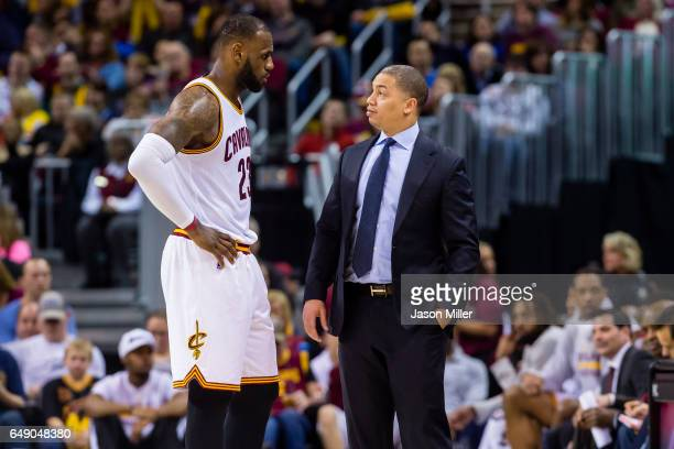 LeBron James talks with head coach Tyronn Lue of the Cleveland Cavaliers during the second half against the Denver Nuggets at Quicken Loans Arena on...
