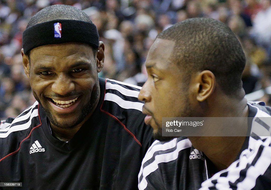 <a gi-track='captionPersonalityLinkClicked' href=/galleries/search?phrase=LeBron+James&family=editorial&specificpeople=201474 ng-click='$event.stopPropagation()'>LeBron James</a> #6 (L) talks with teammate <a gi-track='captionPersonalityLinkClicked' href=/galleries/search?phrase=Dwyane+Wade&family=editorial&specificpeople=201481 ng-click='$event.stopPropagation()'>Dwyane Wade</a> #3 of the Miami Heat during the first half of their game against the Washington Wizards at Verizon Center on December 4, 2012 in Washington, DC.