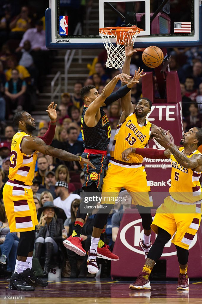 LeBron James Tristan Thompson and JR Smith of the Cleveland Cavaliers guard Thabo Sefolosha of the Atlanta Hawks passes during the first half at...