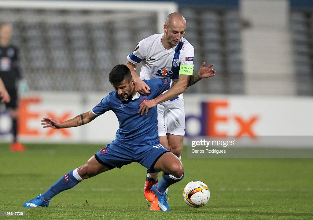 KKS Lech Poznan's forward <a gi-track='captionPersonalityLinkClicked' href=/galleries/search?phrase=Szymon+Pawlowski&family=editorial&specificpeople=8043042 ng-click='$event.stopPropagation()'>Szymon Pawlowski</a> tackles Belenenses's midfielder Tiago Silva during the match between Belenenses v Lech Poznan for the UEFA Europa League: Play Off Round 2nd Leg on November 26, 2015 in Lisbon, Portugal.