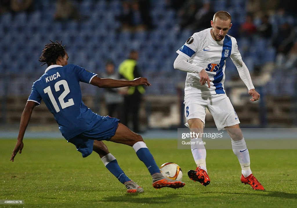 Lech Poznan's forward <a gi-track='captionPersonalityLinkClicked' href=/galleries/search?phrase=Szymon+Pawlowski&family=editorial&specificpeople=8043042 ng-click='$event.stopPropagation()'>Szymon Pawlowski</a> with Os Belenenses' forward Kuca in action during the UEFA Europa League match between Os Belenenses and KKS Lech Poznan at Estadio do Restelo on November 26, 2015 in Lisbon, Portugal.