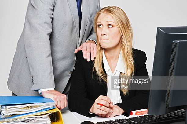 Lecherous businessman harasses helpless young blonde businesswoman