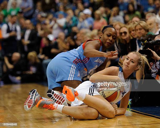 Le'coe Willingham of the Atlanta Dream and Lindsey Moore of the Minnesota Lynx dive for the ball during Game Two of the 2013 WNBA Finals on October 8...