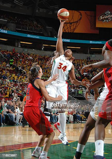 Le'coe Willingham of the Seattle Storm grabs a rebound against Kelly Miller of the Washington Mystics during the game on July 12 2011 at Key Arena in...