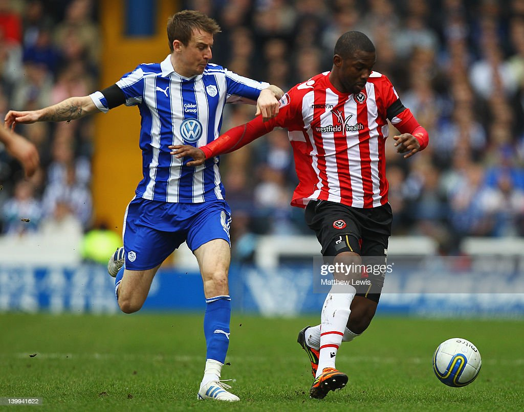 Lecsinel Jean-Francois of Sheffield United and Chris Lines of Sheffield Wednesday challenge for the ball during the npower League One match between Sheffield Wednesday and Sheffield United at Hillsborough Stadium on February 26, 2012 in Sheffield, England.