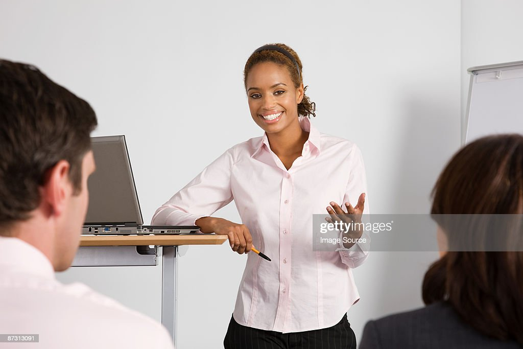 A lecturer teaching business students : Stock Photo