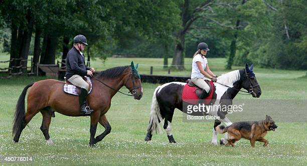 Led by dog Rambo Sheldon Frisch left and daughter Skylar Frisch ride at Patton Park in Hamilton Mass on June 14 2014