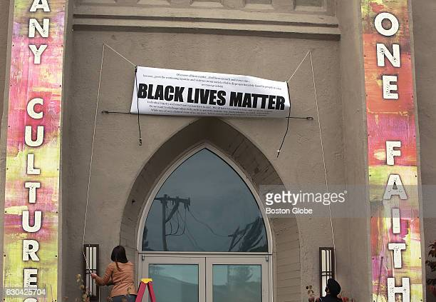 Led by Pastor Ashlee WiestLaird members of First Baptist Church in Boston's Jamaica Plain neighborhood and supporters install a Black Lives Matter...