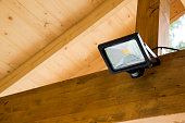 led projector with motion sensor in wooden outdoor carport