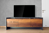 Led TV on TV stand with concrete wall in the living room