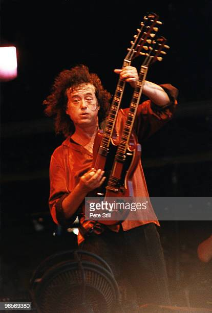 Led Zeppelin guitarist Jimmy Page of Page and Plant performs on stage on Day 3 of The Glastonbury Festival in Somerset on June 25th 1995 in...