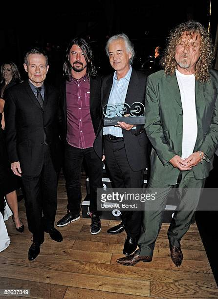 Led Zeppelin members John Paul Jones Jimmy Page and Robert Plant pose with the Outstanding Achievement Award presented by Dave Grohl at the GQ Men Of...