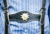Lederhosen close-up, young boy wearing them and blue striped shirt