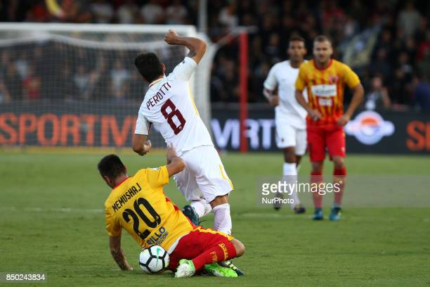 Ledian Memushaj of Benevento competes for the ball in air with Diego Perotti of Roma during the Serie A match between Benevento Calcio and AS Roma at...