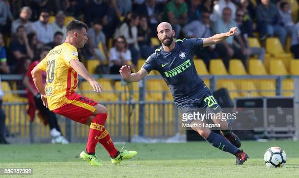 Ledian Memushaj of Benevento competes for the ball with Borja Valero of Inter during the Serie A match between Benevento Calcio and FC Internazionale...