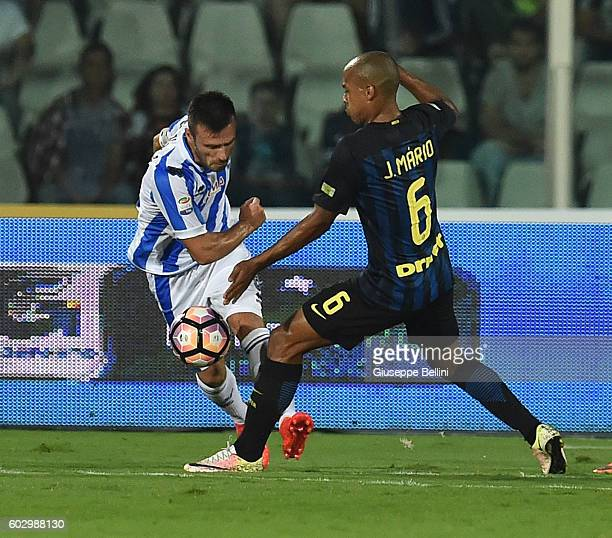 Ledian Memushaj of Pescara Calcio and Joao Mario of FC Internazionale in action during the Serie A match between Pescara Calcio and FC Internazionale...