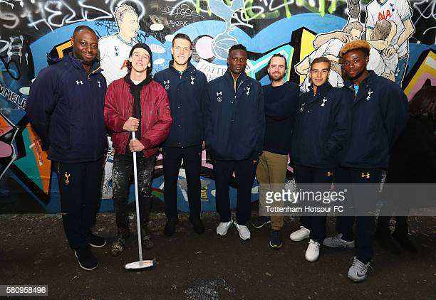 Ledley King Kevin Wimmer Victor Wanyama Harry Winks and Josh Onomah pose with the artists during the unveiling of a Mural of a Spurs goal celebration...