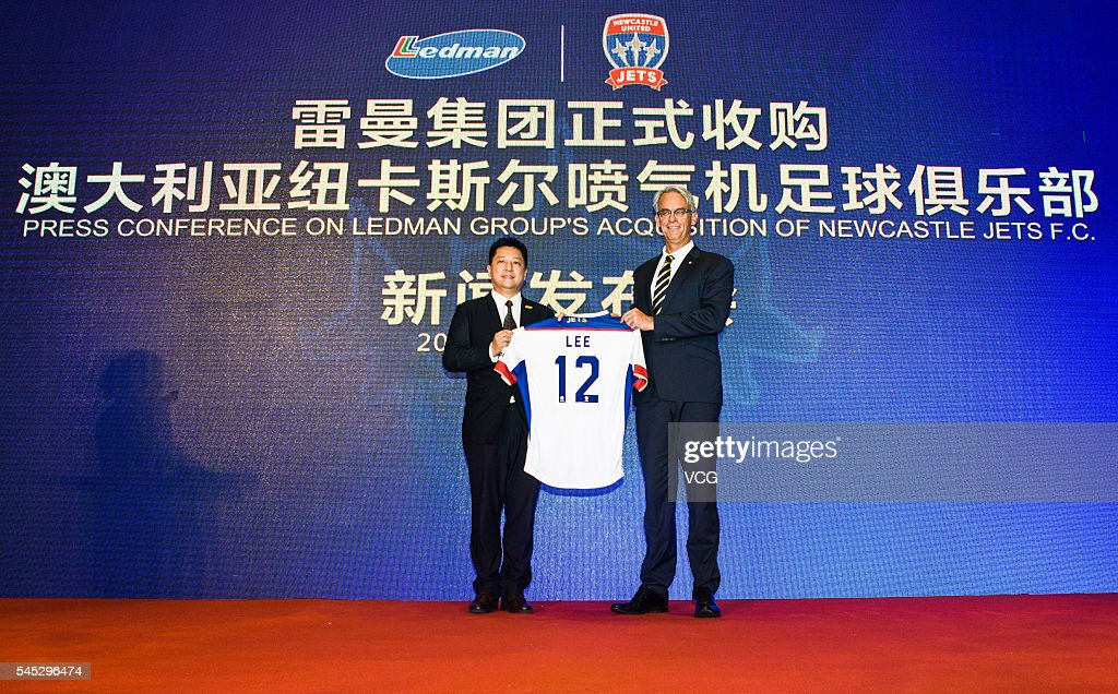 Ledman Group chairman Martin Lee and David Gallop chief executive officer of Football Federation Australia pose for a photo during the press...