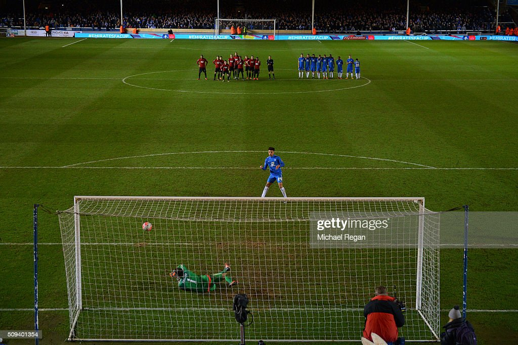 Lee Angol of Peterborough watches as his penalty is saved by <a gi-track='captionPersonalityLinkClicked' href=/galleries/search?phrase=Ben+Foster+-+Voetballer&family=editorial&specificpeople=5333104 ng-click='$event.stopPropagation()'>Ben Foster</a> of West Bromwich Albion during the penalty shootout in the Emirates FA Cup fourth round replay match between Peterborough United and West Bromwich Albion at ABAX Stadium on February 10, 2016 in Peterborough, England.