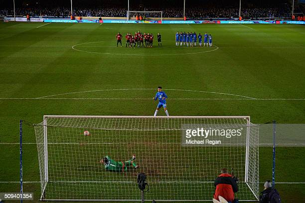 Lee Angol of Peterborough watches as his penalty is saved by Ben Foster of West Bromwich Albion during the penalty shootout in the Emirates FA Cup...