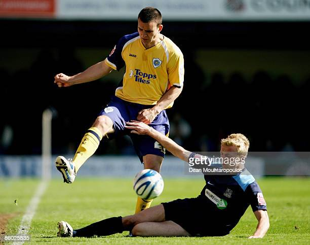 Lee Barnard of Southend tackles Jack Hobbs of Leicester during the CocaCola Football League One match between Southend United and Leicester City at...