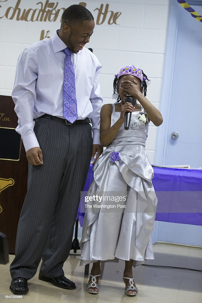 Lee Bassett is delighted as his daughter Shavondra Harkless, 8, after she freestyle rapped for her father during the second annual Date with Dad event at the Richmond City Jail in Richmond,Virginia on March 16, 2013. Shavondra raps, I'm Fresh. I'm Clean. I'm cutest little girl you ever seen. She was so bashful that the only way she could perform the rap was to cover her face while she did it. We Profile the Date with Dad event sponsored by Camp Divas and held at the Marriott in Richmond, Virginia and particularly the Richmond City Jail. The story is about how these father-daughter dances have come under fire for excluding kids without fathers. But in this case, the dance offers a rare chance for the fathers and daughters to bond.