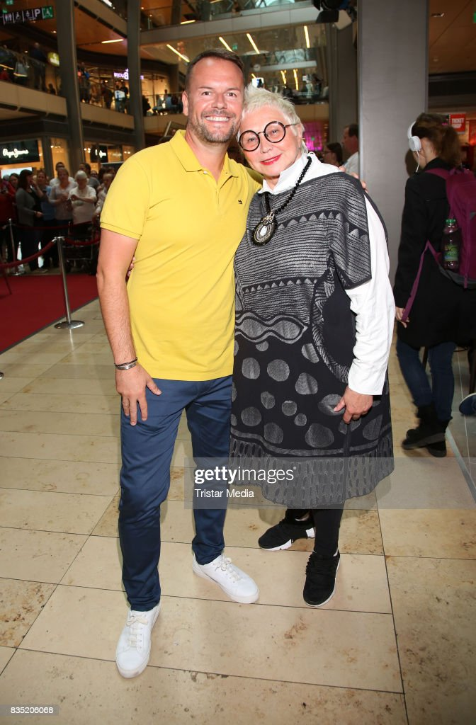 Lee Baxter with PR Lady Brigitte Sely during his autograph session at Europacenter on August 18, 2017 in Hamburg, Germany.