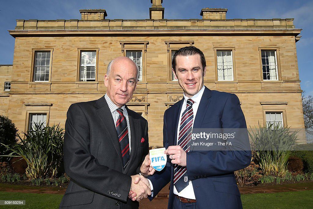 Lee Betts (R) receives his FIFA Assistant Referee badge from David Elleray during the FIFA Referees meeting 2016 at Oulton Hall on February 9, 2016 in Leeds, England.