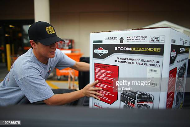 Lee Bittner loads a generator into the back of his truck at Home Depot on August 25 2012 in Tampa Florida Area residents are preparing for Tropical...