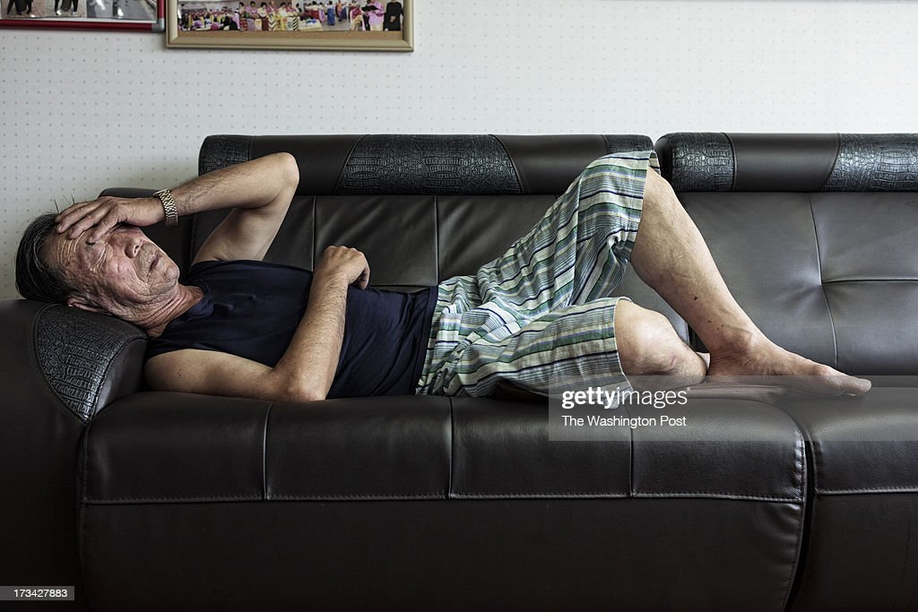 Lee Bong-jeon, 75, takes a nap after lunch at a care house on July 10, 2013 in Seoul, South Korea. Lee escaped from a coal mine in North Korea in 2005.