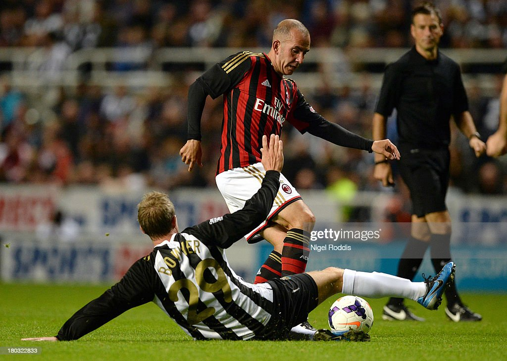 Lee Bowyer (L) of Newcastle United vies for the ball with Paolo Di Canio (R) of AC Milan Glorie during Steve Harper's testimonial match between Newcastle United and AC Milan Glorie at St James' Park on September 11, 2013 in Newcastle upon Tyne, England.
