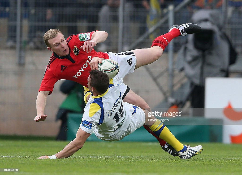 <a gi-track='captionPersonalityLinkClicked' href=/galleries/search?phrase=Lee+Byrne&family=editorial&specificpeople=460147 ng-click='$event.stopPropagation()'>Lee Byrne</a> of Clermont Auvergen is tackled by <a gi-track='captionPersonalityLinkClicked' href=/galleries/search?phrase=Keith+Earls&family=editorial&specificpeople=5409008 ng-click='$event.stopPropagation()'>Keith Earls</a> during the Heineken Cup semi final match between Clermont Auvergne and Munster at Stade de la Mosson on April 27, 2013 in Montpellier, France.