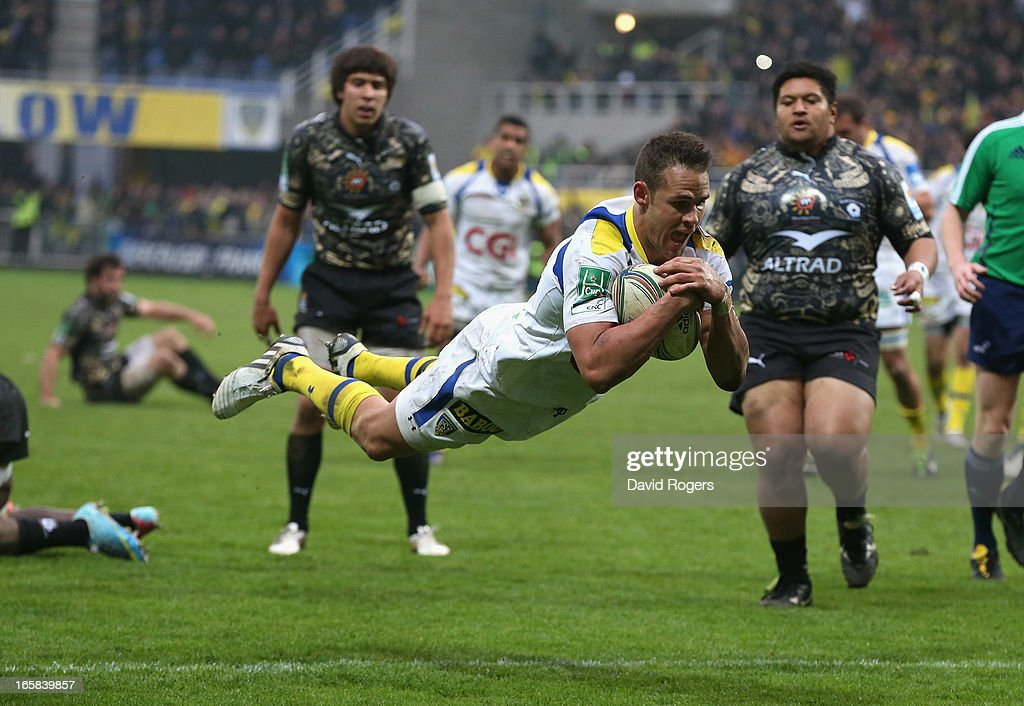 <a gi-track='captionPersonalityLinkClicked' href=/galleries/search?phrase=Lee+Byrne&family=editorial&specificpeople=460147 ng-click='$event.stopPropagation()'>Lee Byrne</a> of Clermont Auvergne dives to score a try during the Heineken Cup quarter final match between Clermont Auvergne and Montpellier at Stade Marcel Michelin on April 6, 2013 in Clermont-Ferrand, France.