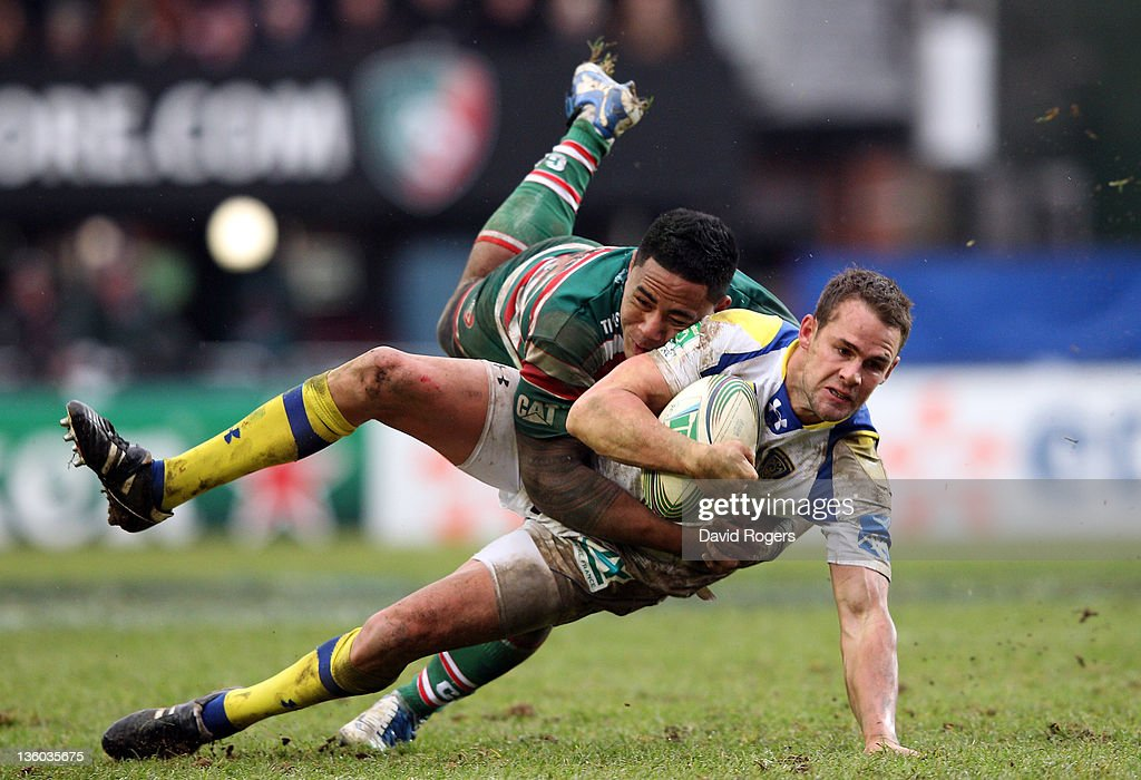 <a gi-track='captionPersonalityLinkClicked' href=/galleries/search?phrase=Lee+Byrne&family=editorial&specificpeople=460147 ng-click='$event.stopPropagation()'>Lee Byrne</a> of Clermont Auvergne is tackled by <a gi-track='captionPersonalityLinkClicked' href=/galleries/search?phrase=Manu+Tuilagi&family=editorial&specificpeople=5493832 ng-click='$event.stopPropagation()'>Manu Tuilagi</a> during the Heineken Cup match between Leicester Tigers and Clermont Auvergne at Welford Road on December 17, 2011 in Leicester, United Kingdom.