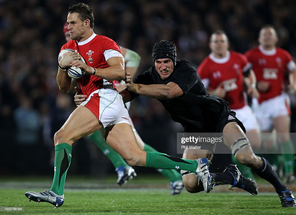 <a gi-track='captionPersonalityLinkClicked' href=/galleries/search?phrase=Lee+Byrne&family=editorial&specificpeople=460147 ng-click='$event.stopPropagation()'>Lee Byrne</a> of Wales is tackled by <a gi-track='captionPersonalityLinkClicked' href=/galleries/search?phrase=Anthony+Boric&family=editorial&specificpeople=541327 ng-click='$event.stopPropagation()'>Anthony Boric</a> of the All Blacks during the First Test match between the New Zealand All Blacks and Wales at Carisbrook on June 19, 2010 in Dunedin, New Zealand.