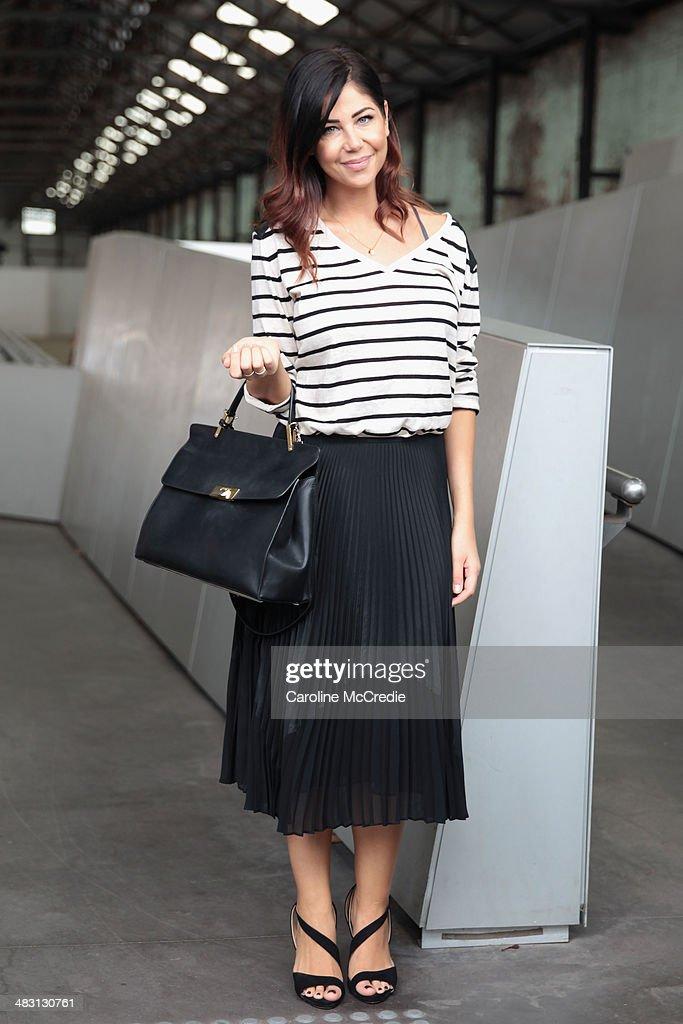 Lee Campbell wearing an HM Top Mark Jacobs skirt Balenciaga handbag and Zara shoes at MercedesBenz Fashion Week Australia 2014 at Carriageworks on...