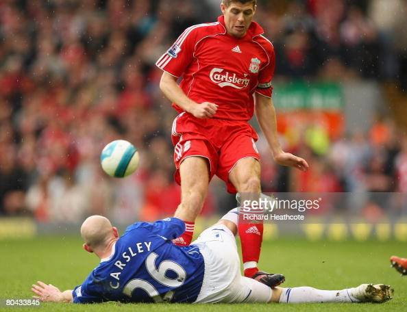 Lee Carsley of Everton is trodden on by Steven Gerrard of Liverpool as they clash for the ball during the Barclays Premier League match between...