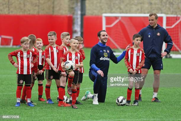 Lee Cattermole and John O'Shea of Sunderland First team training with the U8 academy team at The Academy of Light on April 13 2017 in Sunderland...