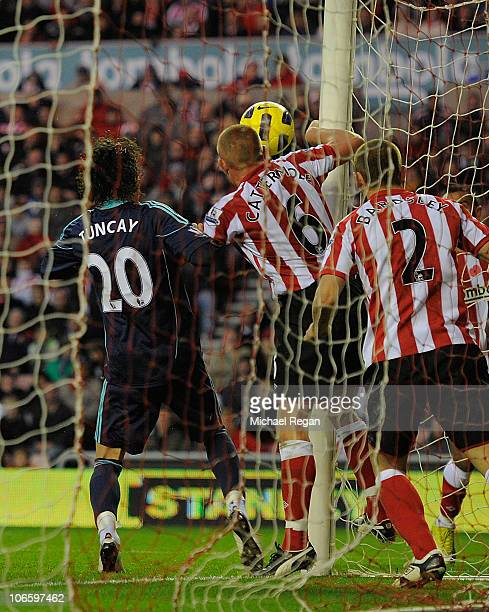 Lee Cattermole appears to handle the ball on the line to deny a goal for Stoke during the Barclays Premier League match between Sunderland and Stoke...